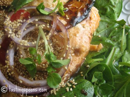 grilled salmon on watercress salad